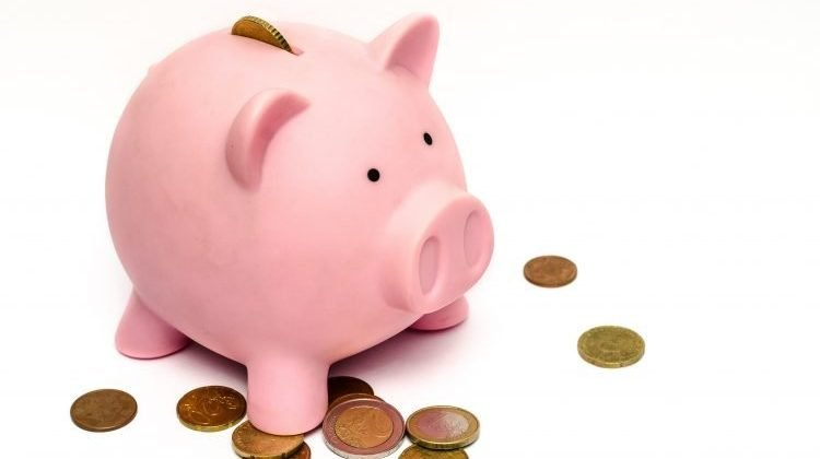 Recommended retirement savings by age piggy bank
