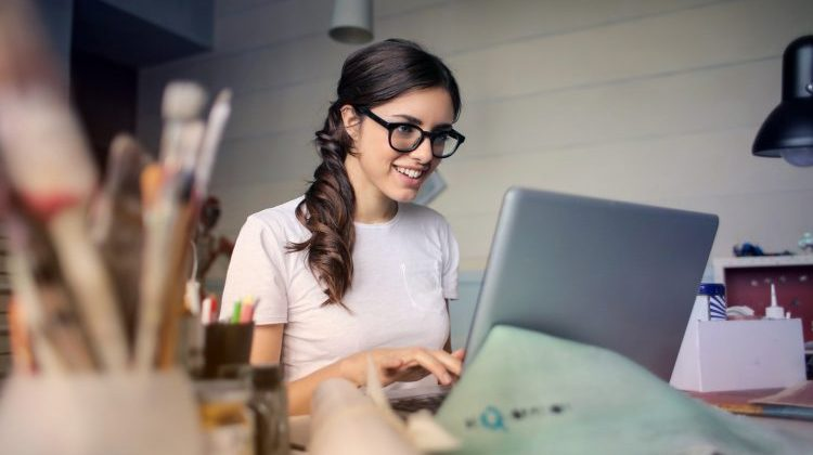 woman working on computer making extra money
